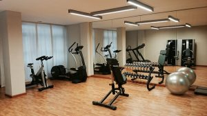 small gym with stationary bikes, free weights and yoga balls